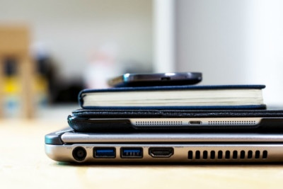 How the right technology can help your business attract the best talent. Picture shows a pile of handy technology, including a laptop, a tablet and a smart phone.